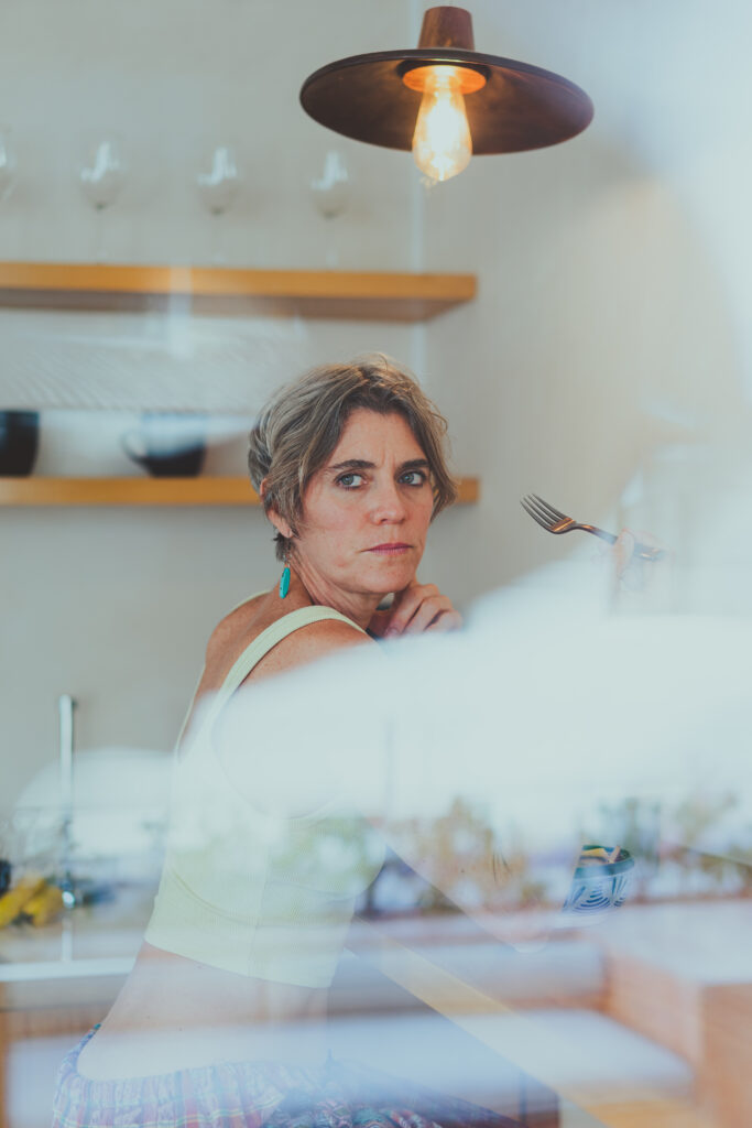 woman distracted from meal on counter at home